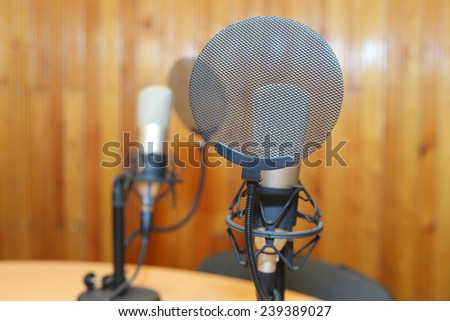 professional microphones in studio closeup - stock photo