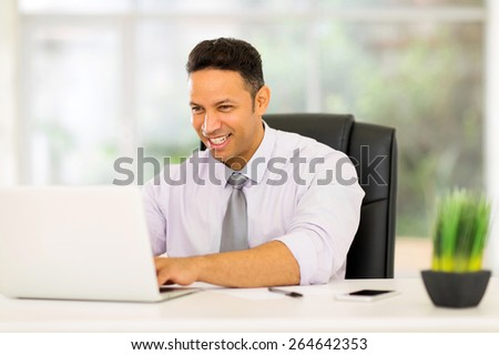 professional mid age corporate worker working on laptop - stock photo
