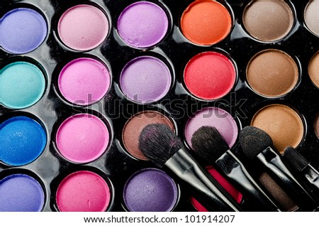 Professional multi colored make-up and brushes - stock photo