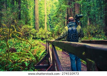 Professional Nature Photographer on Hike with His Photography Equipment.  - stock photo