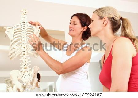Professional physiotherapist explaining the shoulder - stock photo