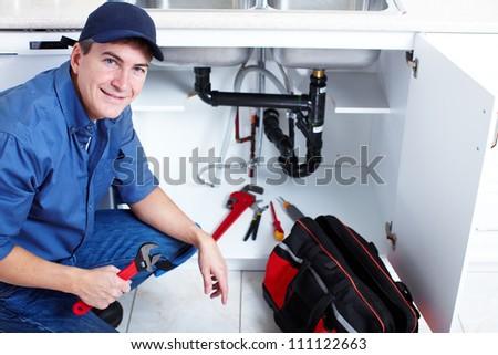 Professional plumber. Plumbing repair service. - stock photo