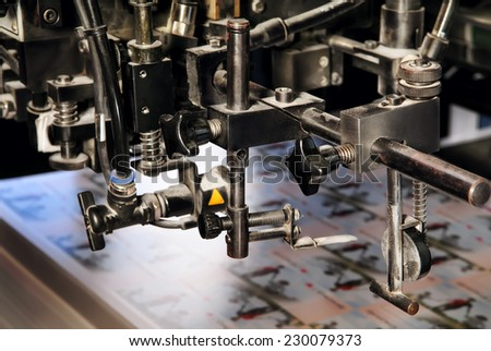 Professional printing machine during operation - stock photo