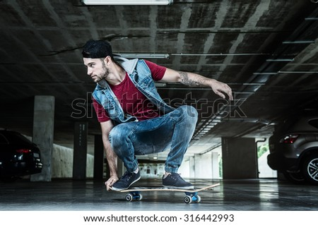 Professional skateboarder in the subway - stock photo