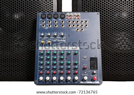 Professional sound mixer and loudspeakers suitable for studio or concert usage - stock photo