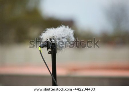 Professional sport microphone on a football field with windshield for live sport broadcasting - stock photo