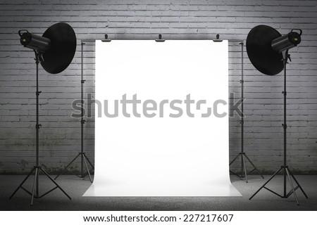 Professional strobe lights illuminating a backdrop - stock photo