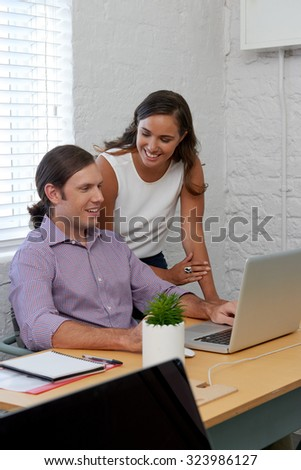 professional supervisor business woman giving work task instructions to colleague on laptop computer in office - stock photo