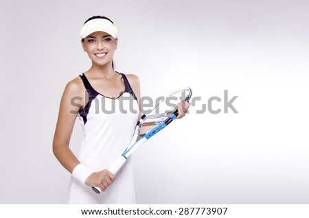 Professional Tennis Concept: Female Tennis Player Equipped in Professional Sport Gear  Holding Racket. Horizontal Image Composition - stock photo