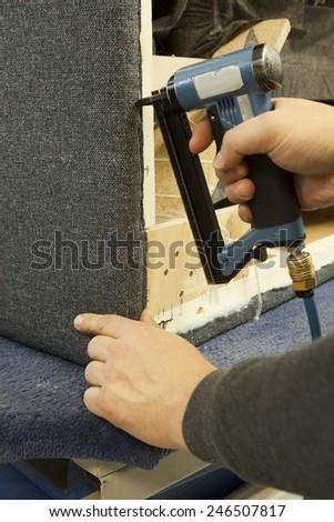 professional upholstery gun, stapler - stock photo