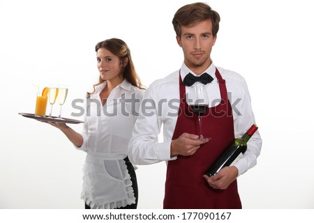 professional waiter and waitress - stock photo