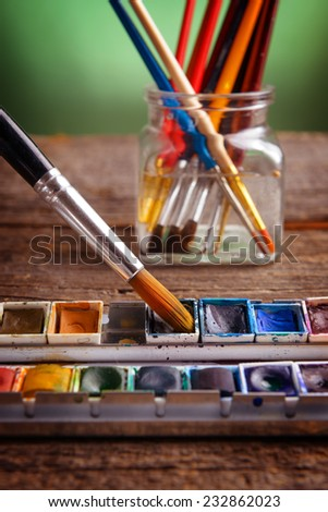 Professional watercolor paints with artistic brushes - stock photo