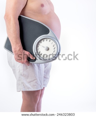 Professional weight scale and Obese male - stock photo
