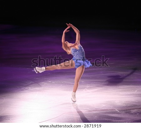 Professional woman figure skater performing at Stars on ice show - stock photo