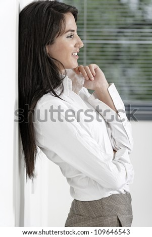 Professional working woman in corporate business trousers and shirt - stock photo