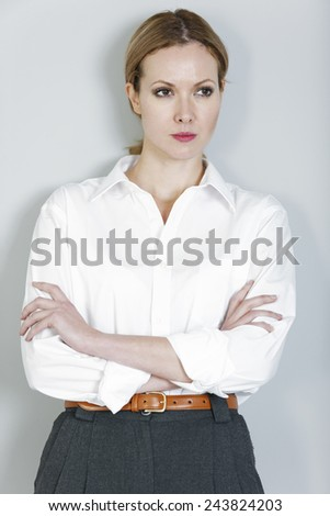 Professional young business woman looking stern and upset. - stock photo