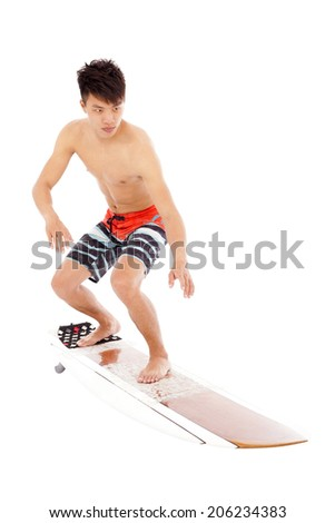 professional young surfer practice surfing pose - stock photo