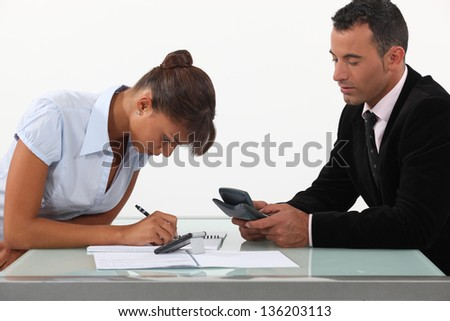 Professionals calculating their budget - stock photo