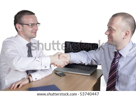 Professionals greet each other at their office - stock photo