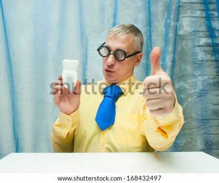Professor of Dentistry with model of tooth - stock photo