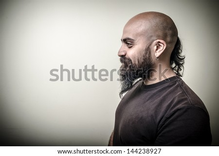 profile bearded man isolated on gray background - stock photo