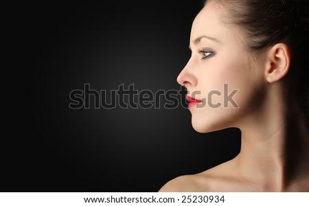 profile of a beautiful woman - stock photo