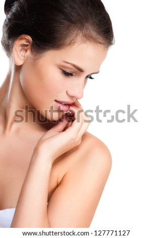 Profile of a beautiful young woman - stock photo