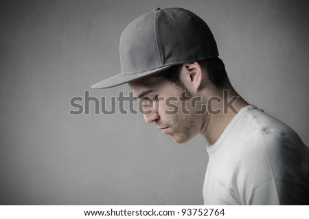 Profile of a handsome man wearing a cap - stock photo