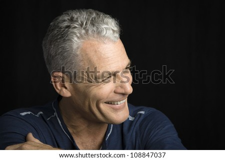 Profile of a handsome man with grey hair - stock photo