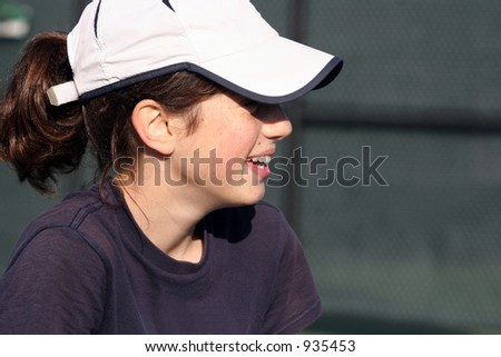 Profile of a happy teen girl - stock photo