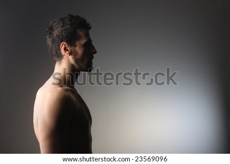 profile of a naked man - stock photo