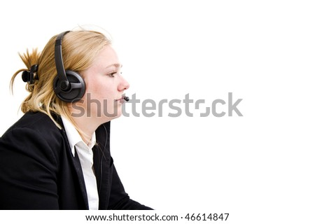 Profile of a professional receptionist with a headset and microphone, answering clients' calls - stock photo