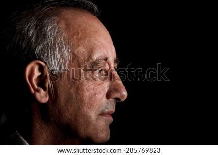 Profile of a senior man on black background, Side view - stock photo