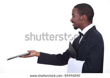 Profile of a waiter with a menu - stock photo