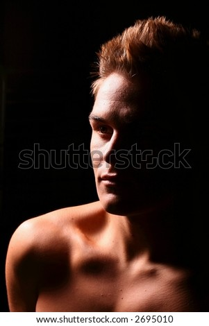 Profile of a young muscular man staring upwards in color - stock photo