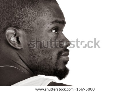 profile of an Afro-Amrican man in B&W against a white background looking up. - stock photo