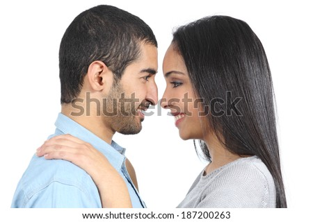 Profile of an arab couple looking each other isolated on a white background          - stock photo