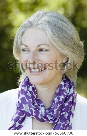 Profile of an Attractive Woman Wearing a Purple Scarf - stock photo