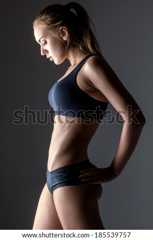 profile of attractive fitness woman, trained female body, lifestyle portrait, caucasian model - stock photo