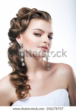 Profile of beautiful haughty bride dressed in white dress. Festive coiffure and makeup - stock photo