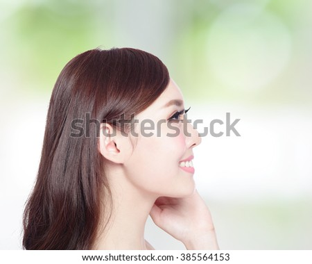 profile of beauty woman with health skin, teeth and hair isolated on green background, asian beauty - stock photo