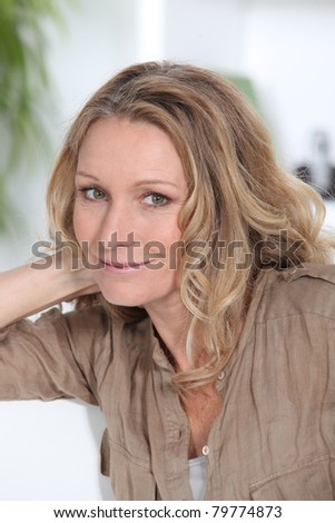 Profile of blond woman smiling - stock photo