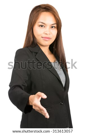 Profile of friendly, warm Asian businesswoman in black business suit grinning, extending hand offering handshake making agreement looking at camera. Thai national of Chinese origin. Vertical half - stock photo