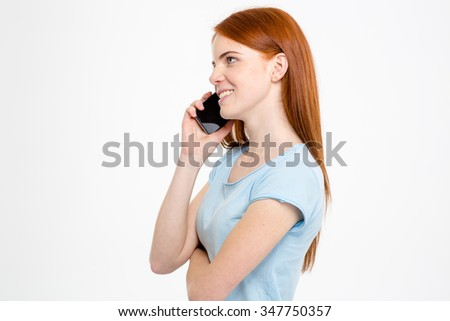 Profile of happy cheerful young woman talking on cellphone isolated over white background - stock photo