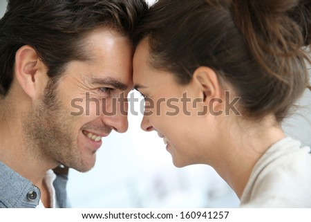 Profile of loving couple looking at each other - stock photo
