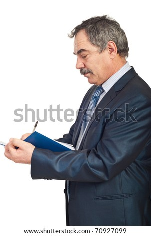 Profile of mature business man writing in personal agenda isolated on white background - stock photo
