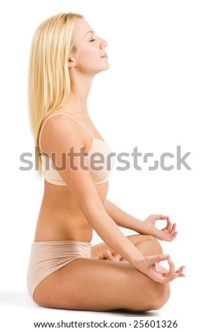 Profile of meditating woman relaxing in pose of lotus over white background - stock photo