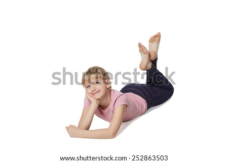 Profile of smiling beautiful girl lying on the floor over white background and looking forward at blank copy space - stock photo