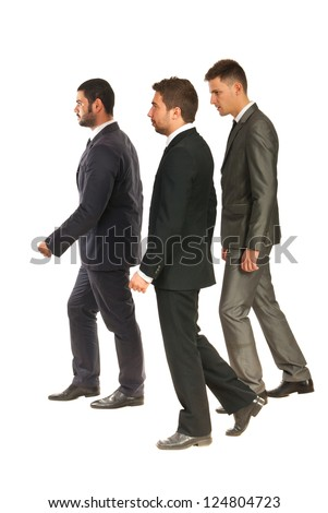 Profile of three business men walking  to work isolated on white background - stock photo