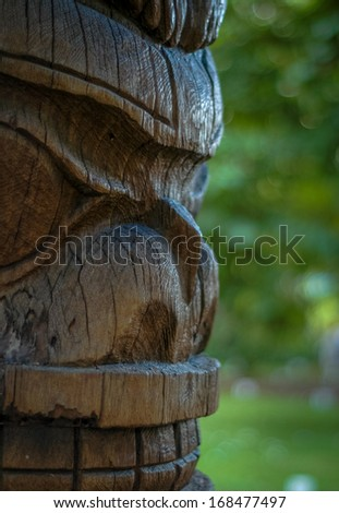Profile Of Totem Pole Face With Room For Text - stock photo